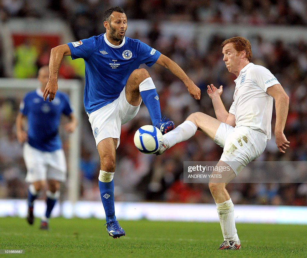 Ryan Giggs (L) competes with England's Damian Lewis during the Unicef Soccer Aid charity football match at Old Trafford in Manchester, north-west England on June 6, 2010. Soccer Aid is the brainchild of Robbie Williams and all money raised through profits from ticket sales and donations made by viewers of ITV during the match will go to UNICEF�s work helping children around the world.