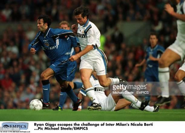 Ryan Giggs escapes the challenge of Inter Milan's Nicola Berti