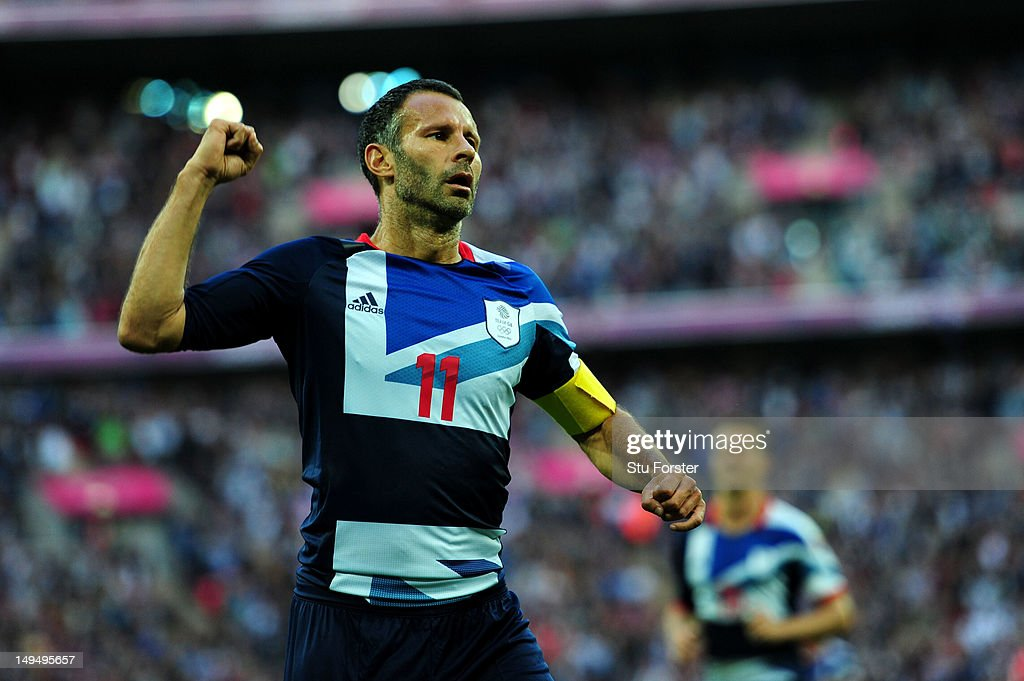 <a gi-track='captionPersonalityLinkClicked' href=/galleries/search?phrase=Ryan+Giggs&family=editorial&specificpeople=201666 ng-click='$event.stopPropagation()'>Ryan Giggs</a> of Great Britain celebrates scoring the opening goal during the Men's Football first round Group A Match between Great Britain and United Arab Emirates on Day 2 of the London 2012 Olympic Games at Wembley Stadium on July 29, 2012 in London, England.