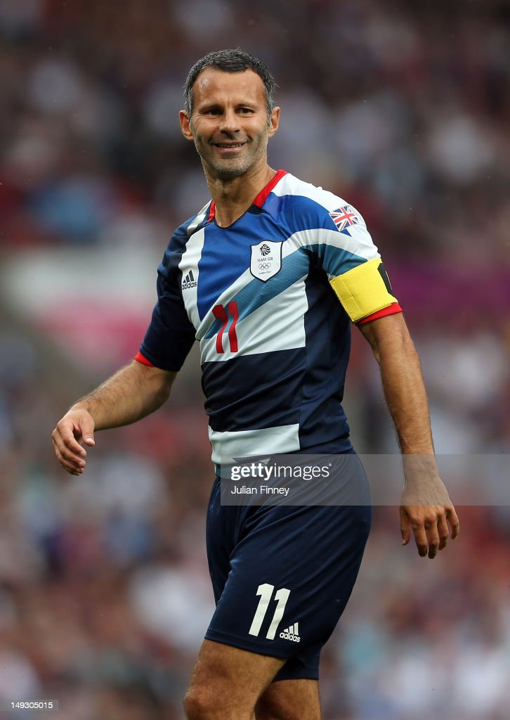 Ryan Giggs of Great Britain smiles during the Men's Football first round Group A Match of the London 2012 Olympic Games between Great Britain and Senegal, at Old Trafford on July 26, 2012 in Manchester, England.