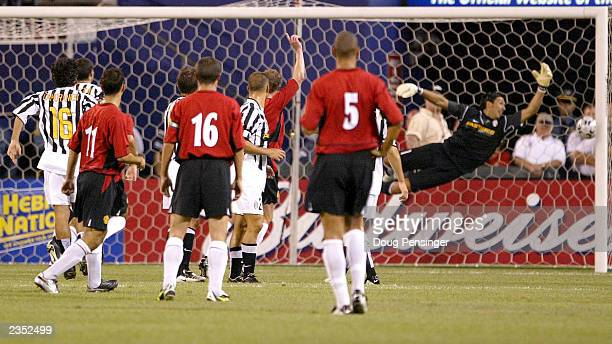 Ryan Giggs of Manchester United and his teammates watch his shot score past Gianluigi Buffon goalkeeper for Juventus at Giants Stadium on July 31...