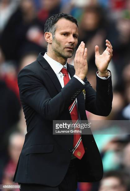 Ryan Giggs of Manchester United applauds the fans after a rousing victory in his first match as manager during the Barclays Premier League match...