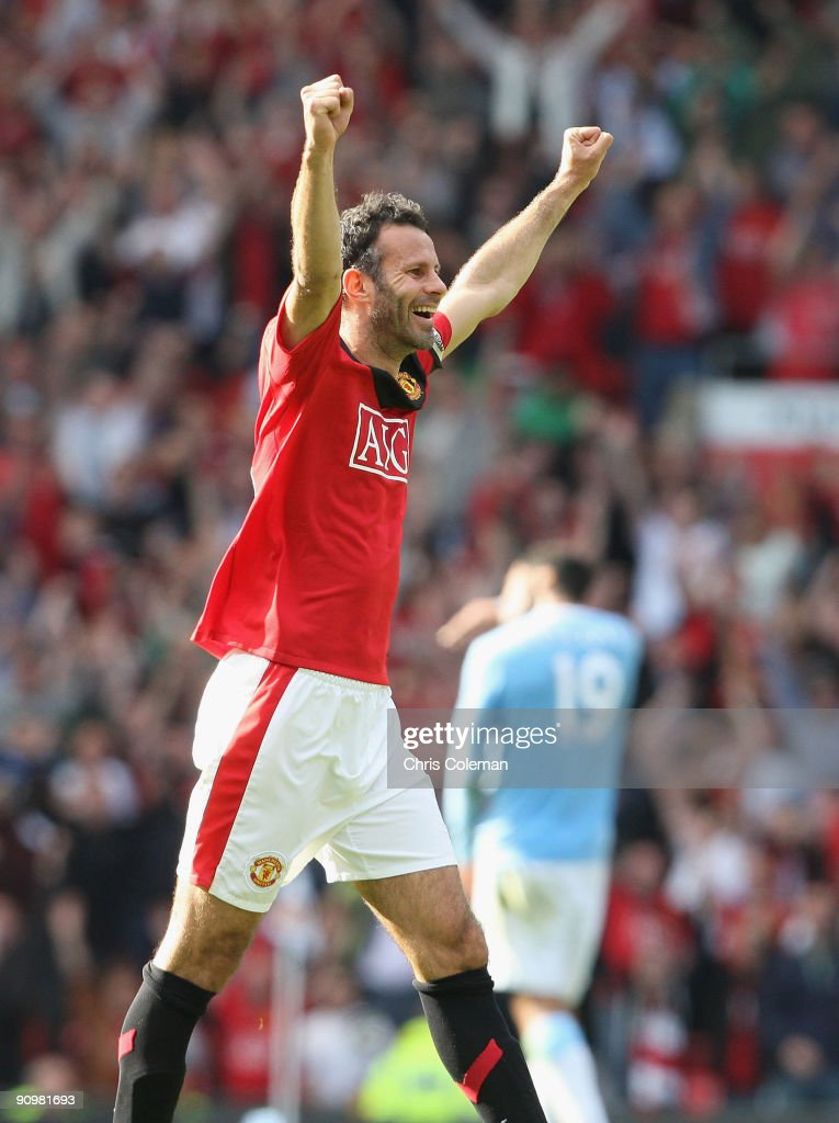 Ryan Giggs of Manchester United celebrates after the FA Barclays Premier League match between Manchester United and Manchester City at Old Trafford on September 20 2009 in Manchester, England.
