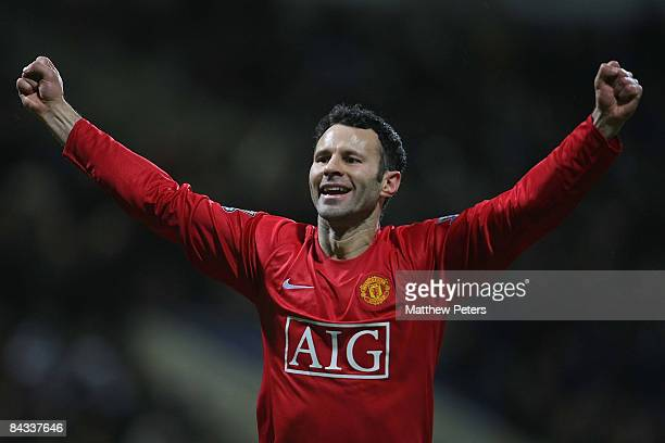 Ryan Giggs of Manchester United celebrates Dimitar Berbatov scoring their first goal during the Barclays Premier League match between Bolton...