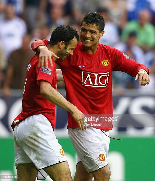 Ryan Giggs of Manchester United celebrates scoring his team's second goal with team mate Cristiano Ronaldo during the Barclays Premier League match...