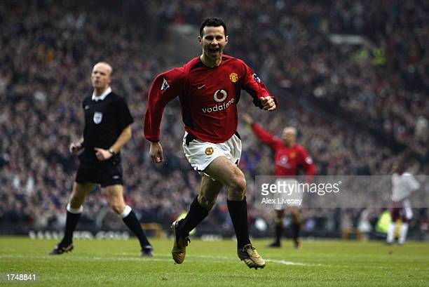 Ryan Giggs of Manchester United celebrates scoring the opening goal of the match during the FA Cup fourth round match between Manchester United and...