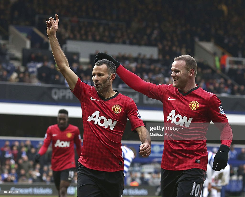 <a gi-track='captionPersonalityLinkClicked' href=/galleries/search?phrase=Ryan+Giggs&family=editorial&specificpeople=201666 ng-click='$event.stopPropagation()'>Ryan Giggs</a> (L) of Manchester United celebrates scoring their second goal during the Barclays Premier League match between Queens Park Rangers and Manchester United at Loftus Road on February 23, 2013 in London, England.