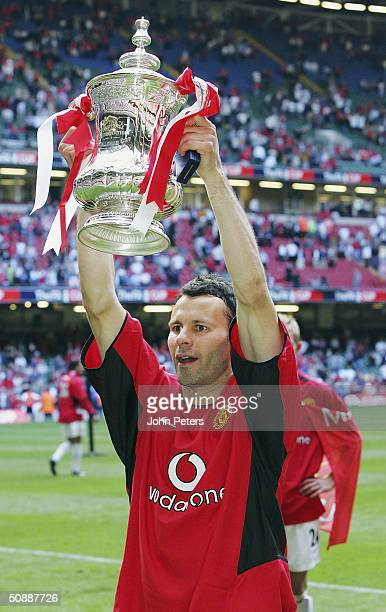Ryan Giggs of Manchester United celebrates with the FA Cup after winning the AXA FA Cup Final between Manchester United and Millwall at the...