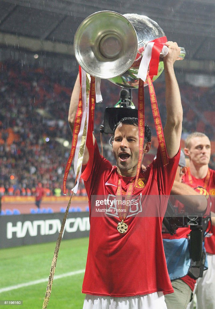 Ryan Giggs of Manchester United celebrates with the trophy after winning the UEFA Champions League Final match between Manchester United and Chelsea at Luzhniki Stadium on May 21 2008 in Moscow, Russia.