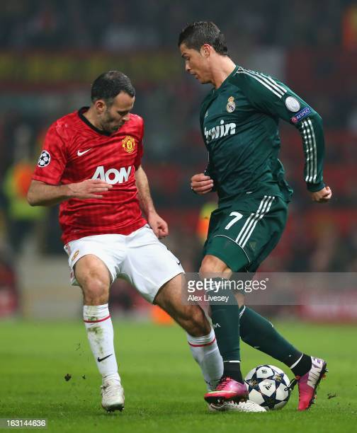 Ryan Giggs of Manchester United challenges Cristiano Ronaldo of Real Madrid during the UEFA Champions League Round of 16 Second leg match between...