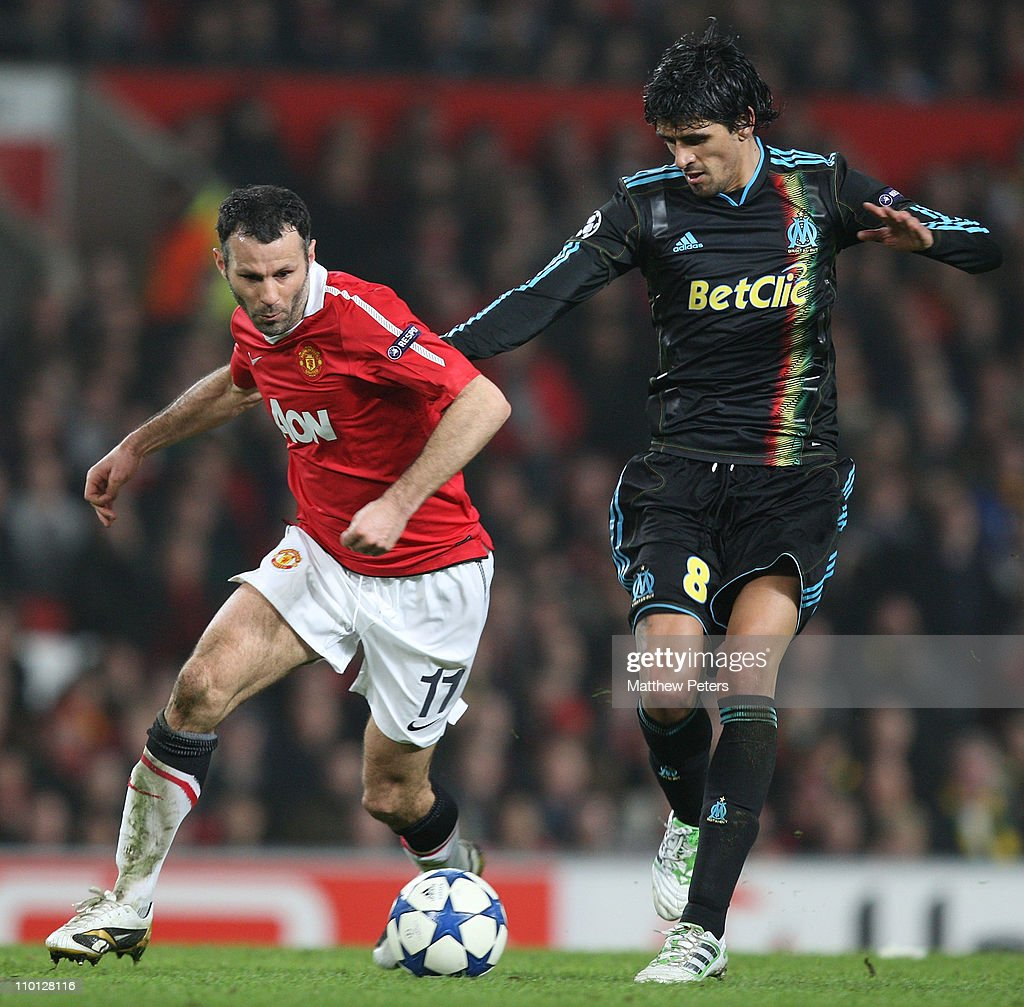 Ryan Giggs of Manchester United clashes with Lucho Gonzalez of Olympique Marseille during the UEFA Champions League Round of 16 match between...
