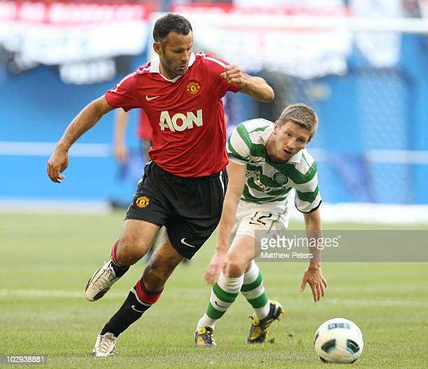 Ryan Giggs of Manchester United clashes with Mark Wilson of Celtic during the preseason friendly match between Manchester United and Celtic at Rogers...