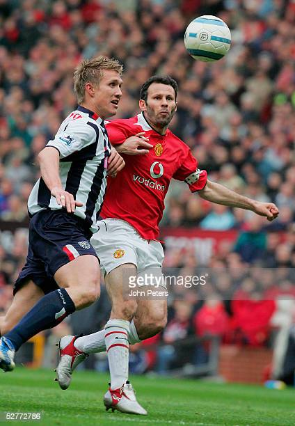 Ryan Giggs of Manchester United clashes with Martin Albrechtsen of West Bromwich Albion during the Barclays Premiership match between Manchester...
