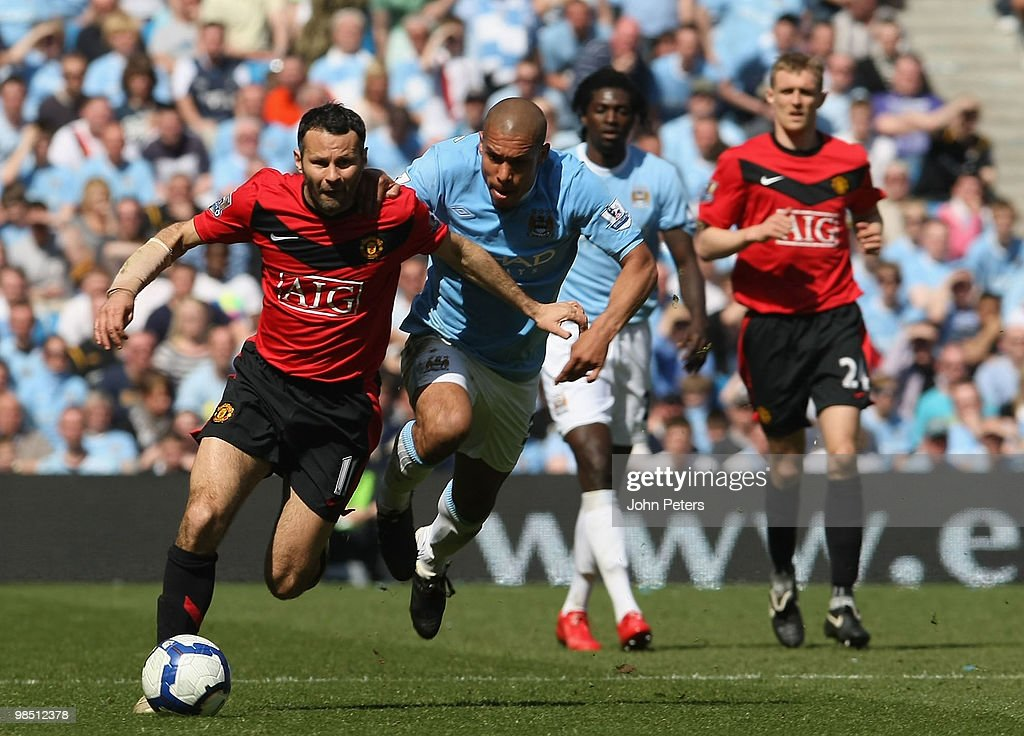 Ryan Giggs of Manchester United clashes with Nigel De Jong of Manchester City during the Barclays Premier League match between Manchester City and...