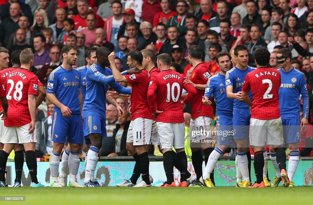 <a gi-track='captionPersonalityLinkClicked' href=/galleries/search?phrase=Ryan+Giggs&family=editorial&specificpeople=201666 ng-click='$event.stopPropagation()'>Ryan Giggs</a> of Manchester United clashes with Ramires and Oscar of Chelsea before Rafael Da Silva is sent off during the Barclays Premier League match between Manchester United and Chelsea at Old Trafford on May 5, 2013 in Manchester, England.