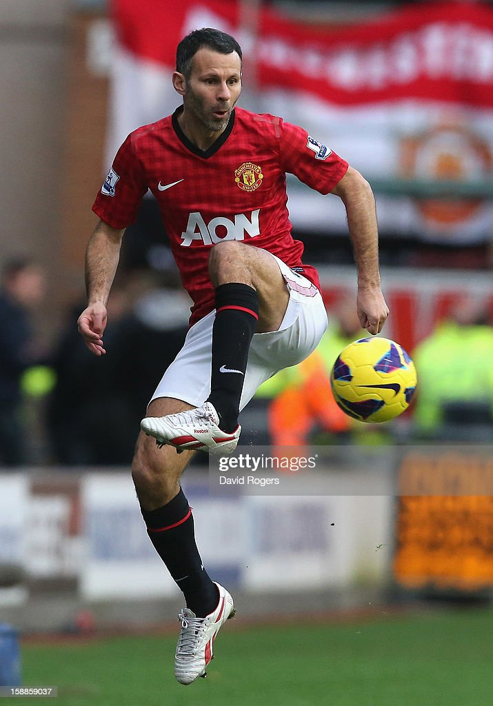 Ryan Giggs of Manchester United controls the ball during the Barclays Premier League match between Wigan Athletic and Manchester United at the DW Stadium on January 1, 2013 in Wigan, England.