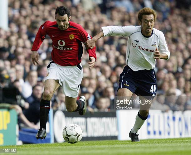 Ryan Giggs of Manchester United gets away from Kazuyuki Toda of Tottenham Hotspur during the FA Barclaycard Premiership match between Tottenham...