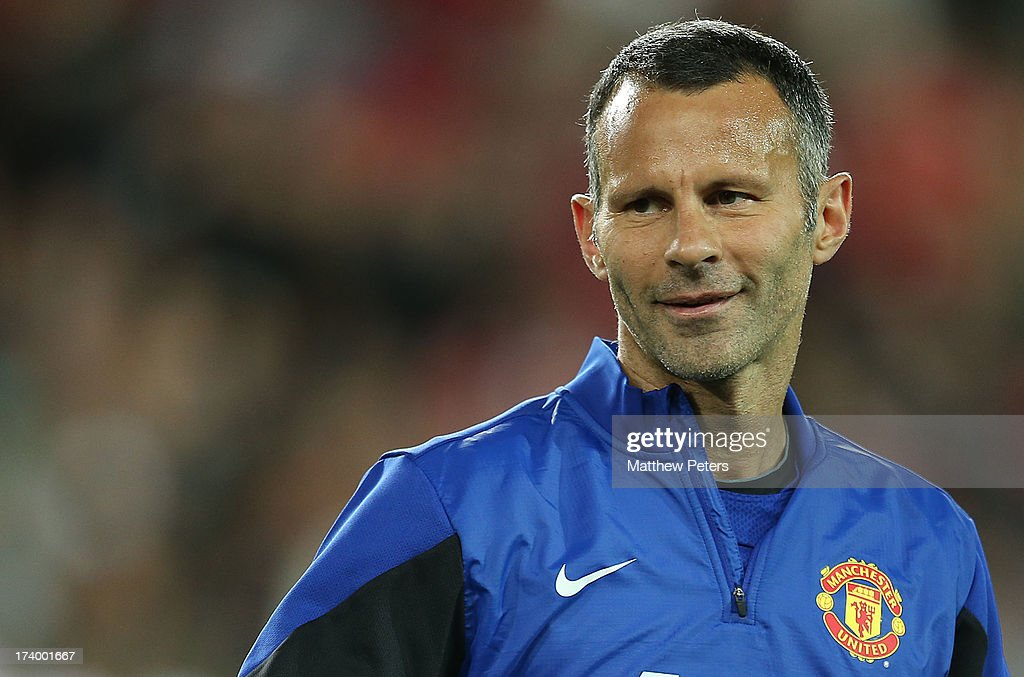 <a gi-track='captionPersonalityLinkClicked' href=/galleries/search?phrase=Ryan+Giggs&family=editorial&specificpeople=201666 ng-click='$event.stopPropagation()'>Ryan Giggs</a> of Manchester United in action during a first team training session as part of their pre-season tour of Bangkok, Australia, China, Japan and Hong Kong on July 19, 2013 in Sydney, Australia.