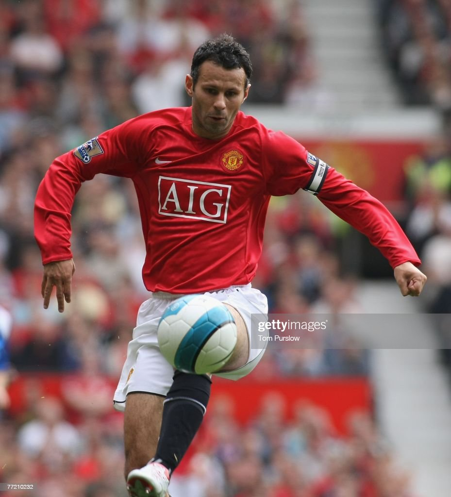 Ryan Giggs of Manchester United in action on the ball during the Barclays FA Premier League match between Manchester United and Wigan Athletic at Old Trafford on October 6 2007, in Manchester, England.