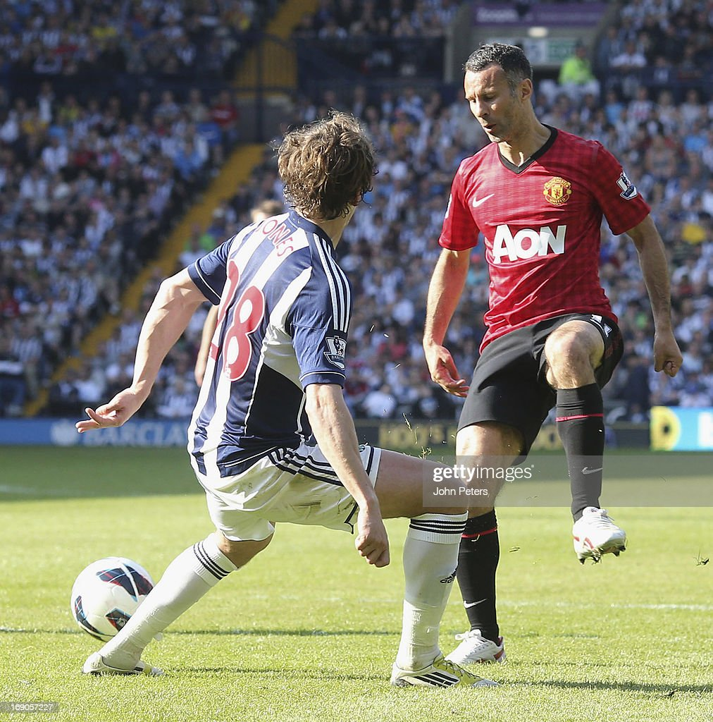 Ryan Giggs of Manchester United in action with Billy Jones of West Bromwich Albion during the Barclays Premier League match between Wet Bromwich Albion and Manchester United at The Hawthorns on May 19, 2013 in West Bromwich, England.