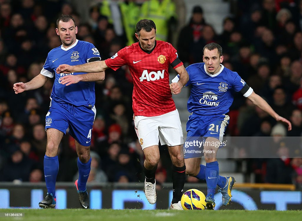 Ryan Giggs of Manchester United in action with Darron Gibson (L) and Leon Osman of Everton during the Barclays Premier League match between Manchester United and Everton at Old Trafford on February 10, 2013 in Manchester, England.