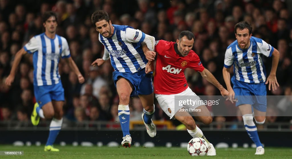 <a gi-track='captionPersonalityLinkClicked' href=/galleries/search?phrase=Ryan+Giggs&family=editorial&specificpeople=201666 ng-click='$event.stopPropagation()'>Ryan Giggs</a> of Manchester United in action with Markel Bergara of Real Sociedad during the UEFA Champions League Group A match between Manchester United and Real Sociedad at Old Trafford on October 23, 2013 in Manchester, England.