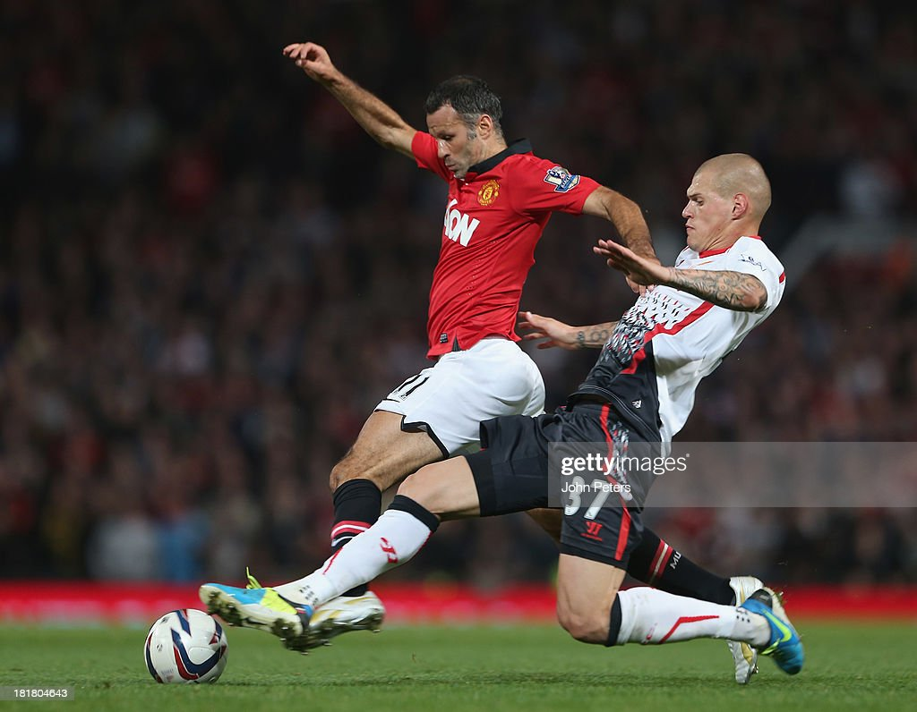 Ryan Giggs of Manchester United in action with Martin Skrtel of Liverpool during the Capital Cup Third Round match between Manchester United and Liverpool at Old Trafford on September 25, 2013 in Manchester, England.