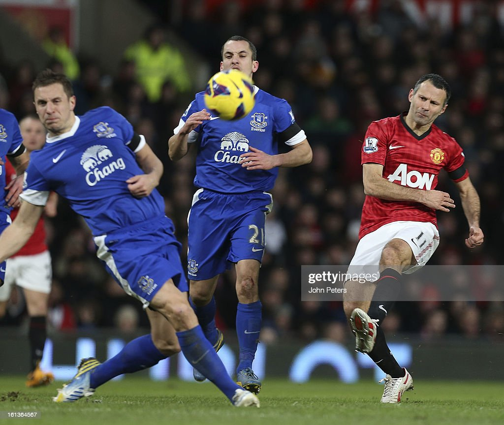 Ryan Giggs of Manchester United in action with Phil Jagielka of Everton during the Barclays Premier League match between Manchester United and Everton at Old Trafford on February 10, 2013 in Manchester, England.