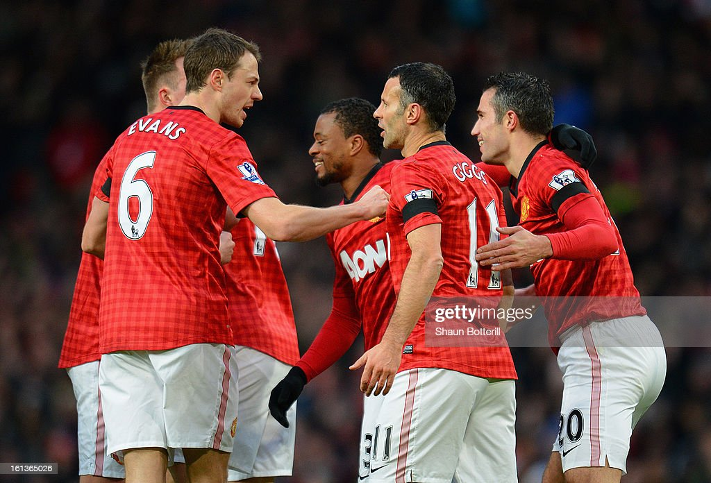 Ryan Giggs of Manchester United is congratulated by his team-mates after scoring the opening goal during the Barclays Premier League match between Manchester United and Everton at Old Trafford on February 10, 2013 in Manchester, England.