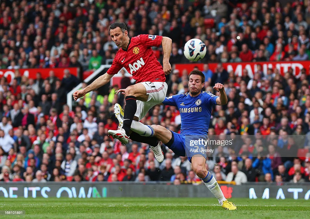 <a gi-track='captionPersonalityLinkClicked' href=/galleries/search?phrase=Ryan+Giggs&family=editorial&specificpeople=201666 ng-click='$event.stopPropagation()'>Ryan Giggs</a> of Manchester United is tackled by Cesar Azpilicueta of Chelsea during the Barclays Premier League match between Manchester United and Chelsea at Old Trafford on May 5, 2013 in Manchester, England.