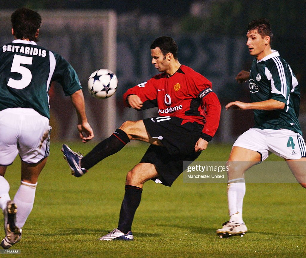 Ryan Giggs of Manchester United keeps the ball away from Giorgos Seitaridis and Silvio Maric of Panathinaikos during the UEFA Champions League match...