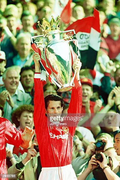 Ryan Giggs of Manchester United lifts the Premiership Trophy after the club becomes FA Carling Premiership Winners in the 199394 season at Old...