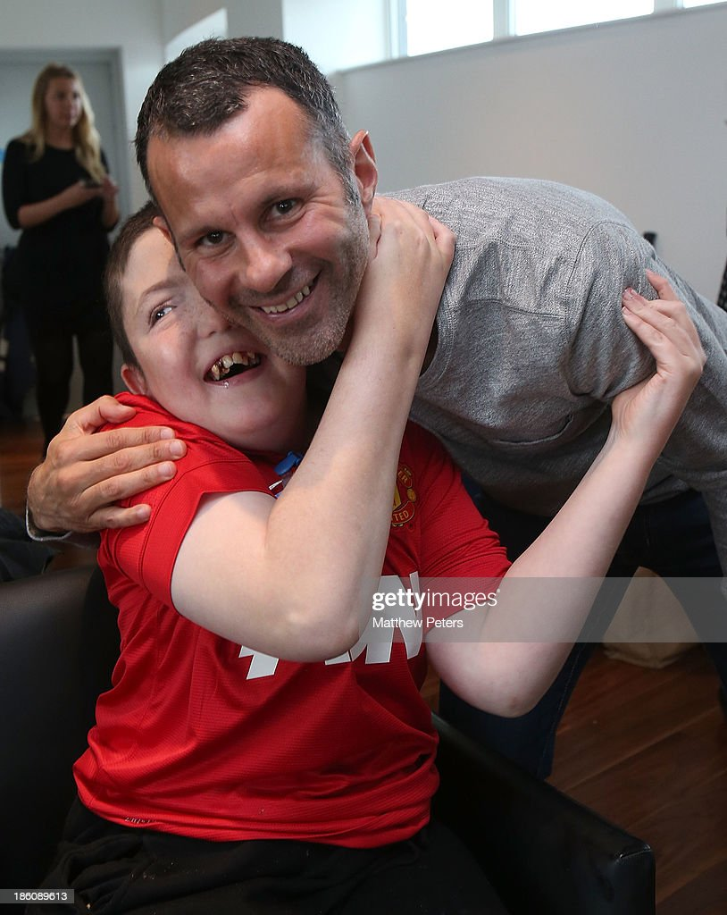 Ryan Giggs of Manchester United meets Harry at a Manchester United Foundation Dream Day, for fans with life-limiting illnesses, at Aon Training Complex on October 28, 2013 in Manchester, England.