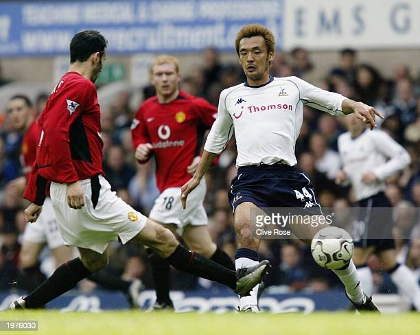 Ryan Giggs of Manchester United passes the ball past Kazuyuki Toda of Tottenham Hotspur during the FA Barclaycard Premiership match between Tottenham...