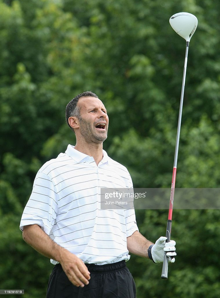 <a gi-track='captionPersonalityLinkClicked' href=/galleries/search?phrase=Ryan+Giggs&family=editorial&specificpeople=201666 ng-click='$event.stopPropagation()'>Ryan Giggs</a> of Manchester United plays golf at Newcastle Golf Club as part of their pre-season tour of the USA on July 16, 2011 in Seattle, Washington.