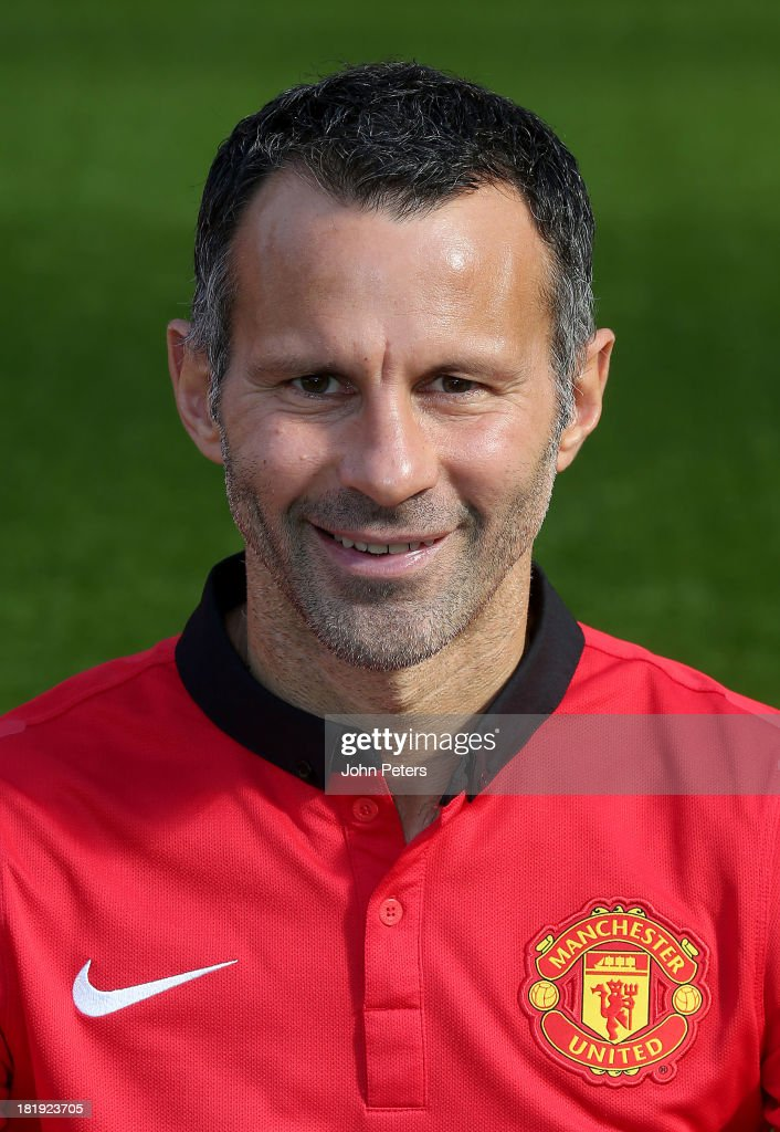 <a gi-track='captionPersonalityLinkClicked' href=/galleries/search?phrase=Ryan+Giggs&family=editorial&specificpeople=201666 ng-click='$event.stopPropagation()'>Ryan Giggs</a> of Manchester United poses at the annual club photocall at Old Trafford on September 26, 2013 in Manchester, England.