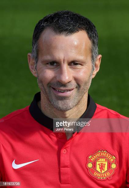 Ryan Giggs of Manchester United poses at the annual club photocall at Old Trafford on September 26 2013 in Manchester England
