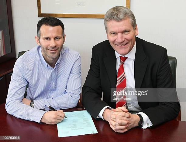 Ryan Giggs of Manchester United poses with Chief Executive David Gill after signing a contract extension until the end of next season at Old Trafford...