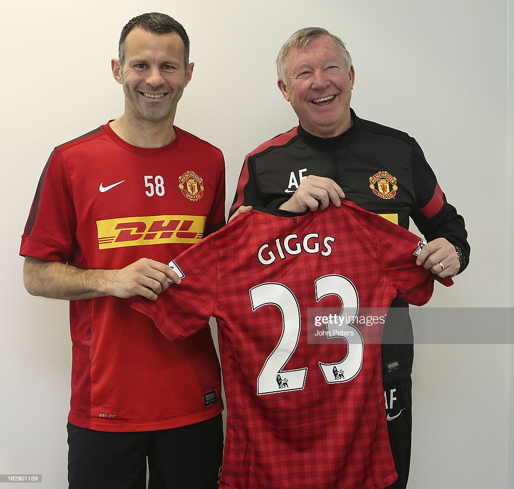 <a gi-track='captionPersonalityLinkClicked' href=/galleries/search?phrase=Ryan+Giggs&family=editorial&specificpeople=201666 ng-click='$event.stopPropagation()'>Ryan Giggs</a> of Manchester United (L) poses with Manager Sir <a gi-track='captionPersonalityLinkClicked' href=/galleries/search?phrase=Alex+Ferguson&family=editorial&specificpeople=203067 ng-click='$event.stopPropagation()'>Alex Ferguson</a> after signing a new one-year extension to his contract with the club at Carrington Training Ground on March 1, 2013 in Manchester, England.