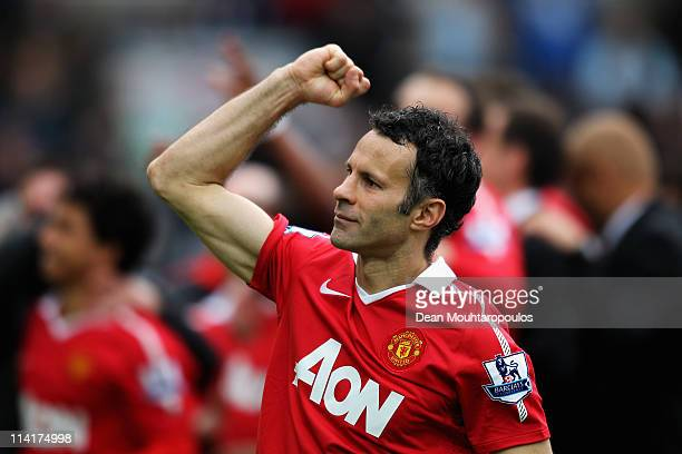 Ryan Giggs of Manchester United pumps his fist to the fans after drawing the Barclays Premier League match between Blackburn Rovers and Manchester...