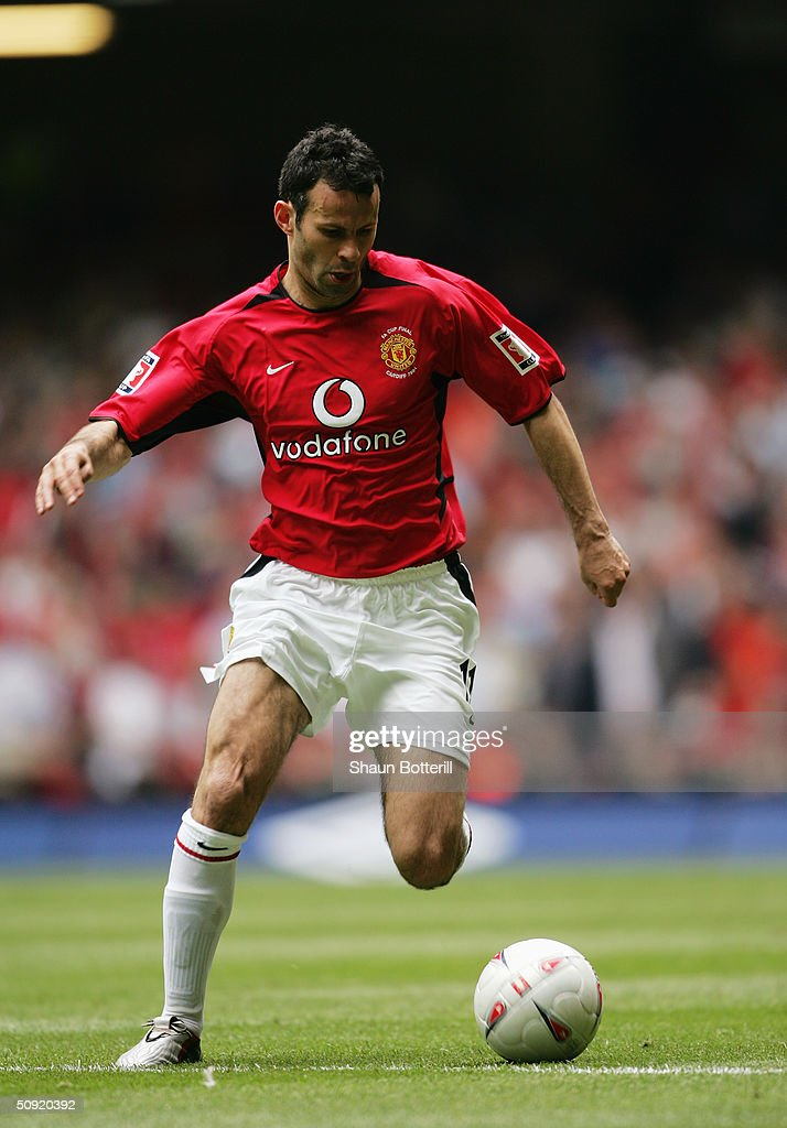 Ryan Giggs of Manchester United runs with the ball during the 123rd FA Cup Final between Manchester United and Millwall held at The Millennium Stadium on May 22, 2004 in Cardiff, Wales.