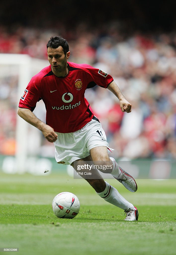 Ryan Giggs of Manchester United runs with the ball during the 123rd FA Cup Final between Manchester United and Millwall at The Millennium Stadium on May 22, 2004 in Cardiff, Wales.