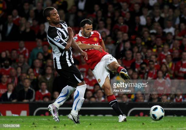 Ryan Giggs of Manchester United scores his team's third goal during the Barclays Premier League match between Manchester United and Newcastle United...