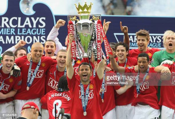 Ryan Giggs of Manchester United squad lifts the Premiership trophy after the Barclays FA Premier League match between Wigan Athletic and Manchester...