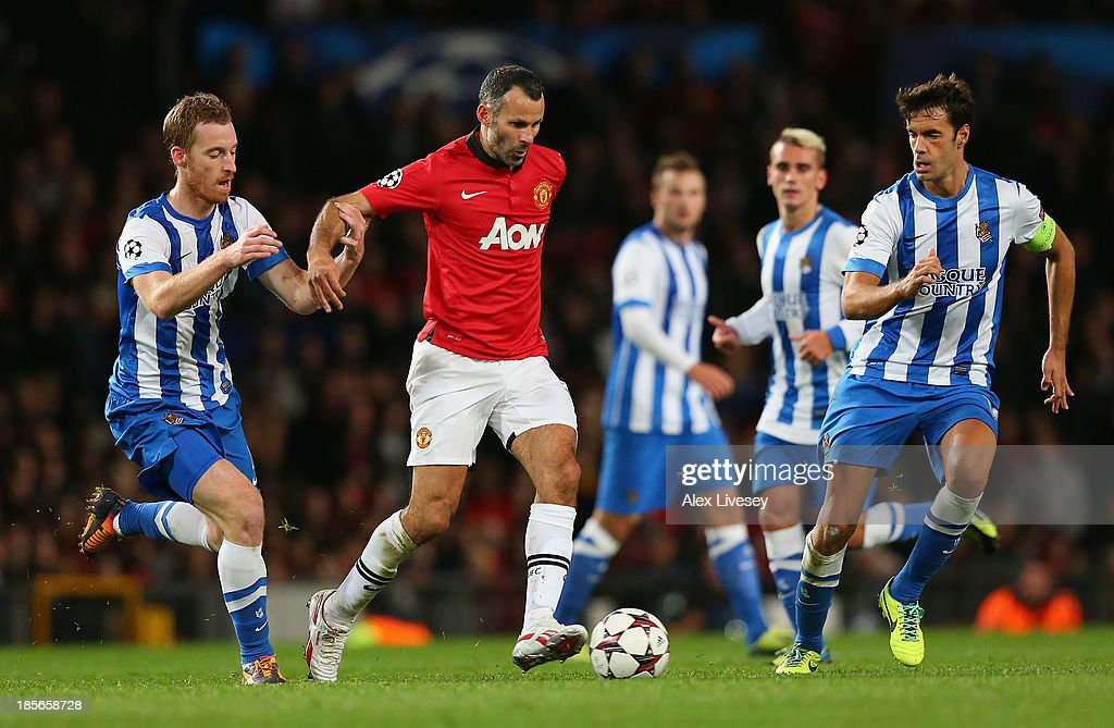 <a gi-track='captionPersonalityLinkClicked' href=/galleries/search?phrase=Ryan+Giggs&family=editorial&specificpeople=201666 ng-click='$event.stopPropagation()'>Ryan Giggs</a> of Manchester United surges forward during the UEFA Champions League Group A match between Manchester United and Real Sociedad at Old Trafford on October 23, 2013 in Manchester, England.