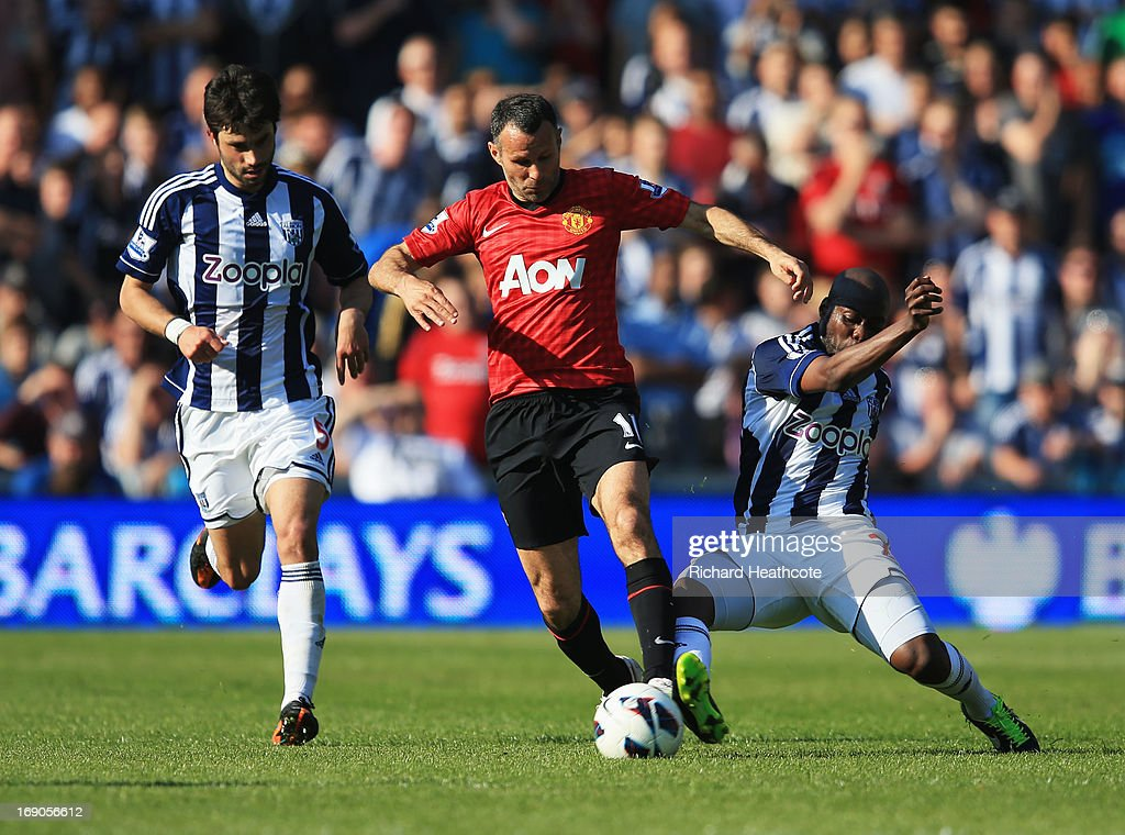 Ryan Giggs of Manchester United takes on Claudio Yacob (L) and Youssuf Mulumbu of West Bromwich Albion during the Barclays Premier League match between West Bromwich Albion and Manchester United at The Hawthorns on May 19, 2013 in West Bromwich, England.