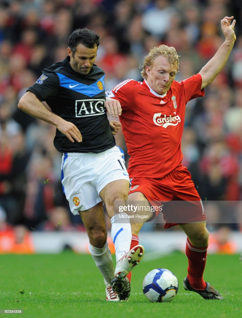 Ryan Giggs of Manchester United tussles for posession with Dirk Kuyt of Liverpool during the Barclays Premier League match between Liverpool and...