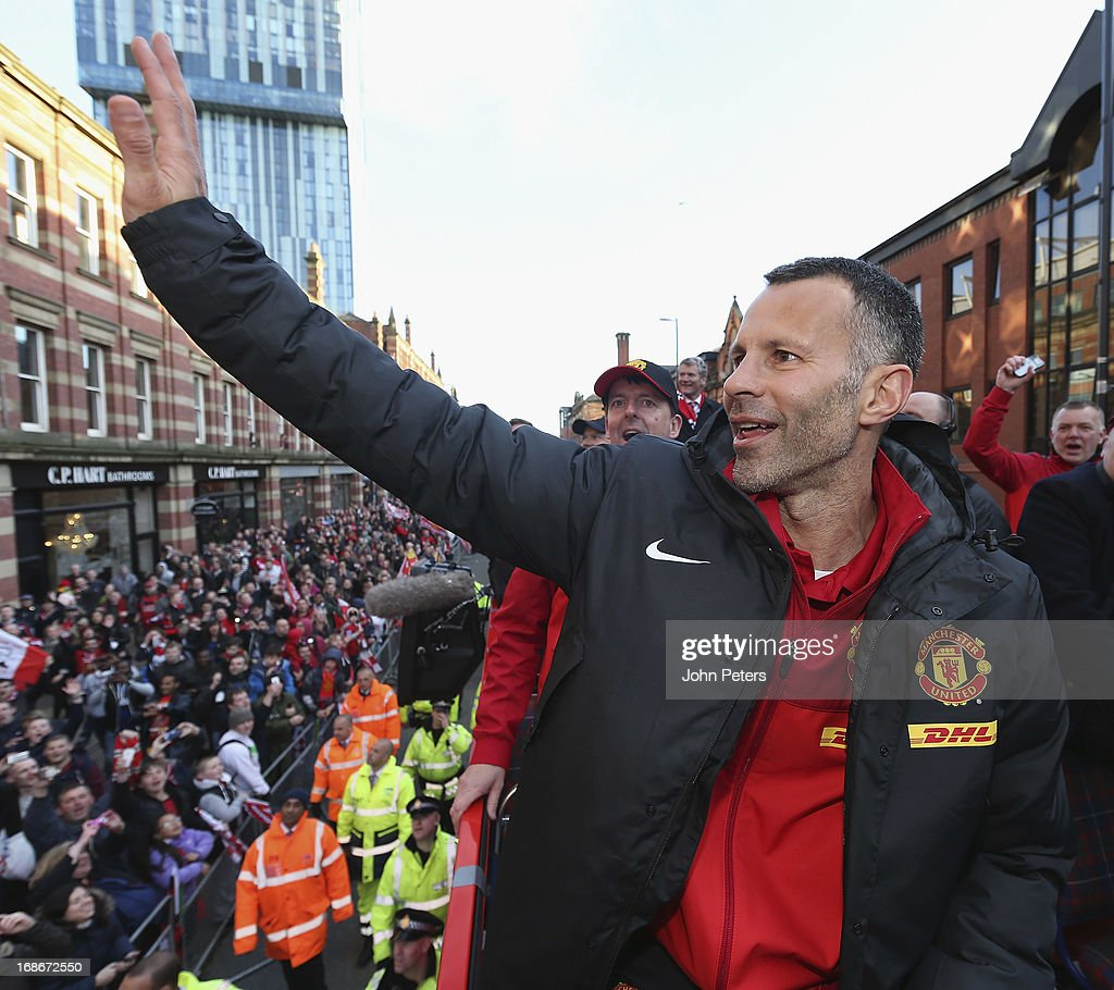 Ryan Giggs of Manchester United waves to the crowd on their Barclays Premier League Trophy Parade through Manchester on May 13, 2013 in Manchester, England.