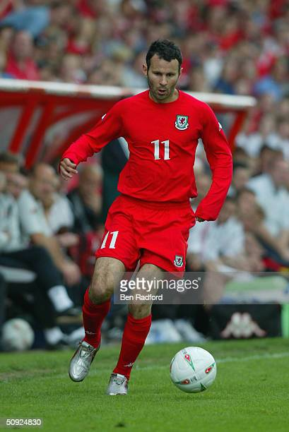 Ryan Giggs of Wales runs with the ball during the international friendly match between Wales and Canada at the Racecourse Ground on May 30 2004 in...
