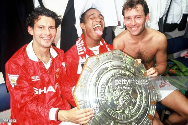 Ryan Giggs Paul Ince and Bryan Robson celebrate in the dressing room after the Arsenal v Manchester United Charity Shield match at Wembley Stadium...